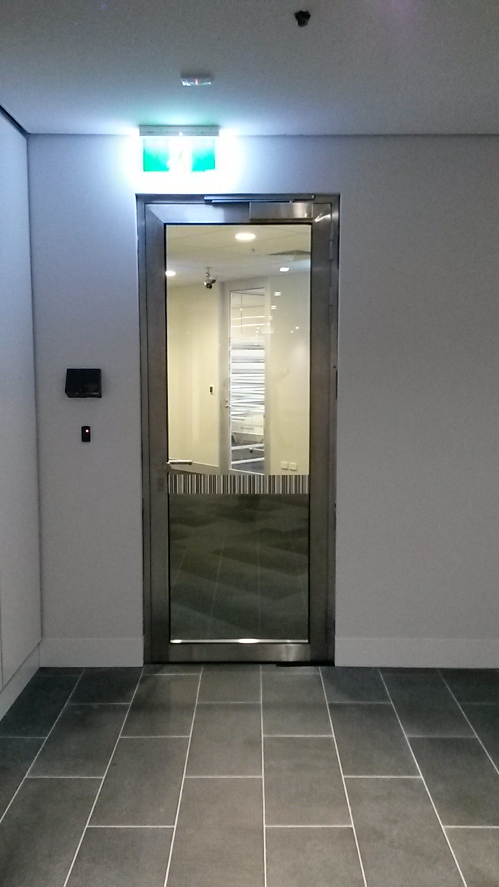 stainless steel glass fire doors to cba melbourne. Black Bedroom Furniture Sets. Home Design Ideas